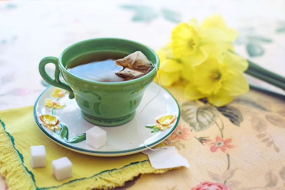 teacup on a saucer with daffodils